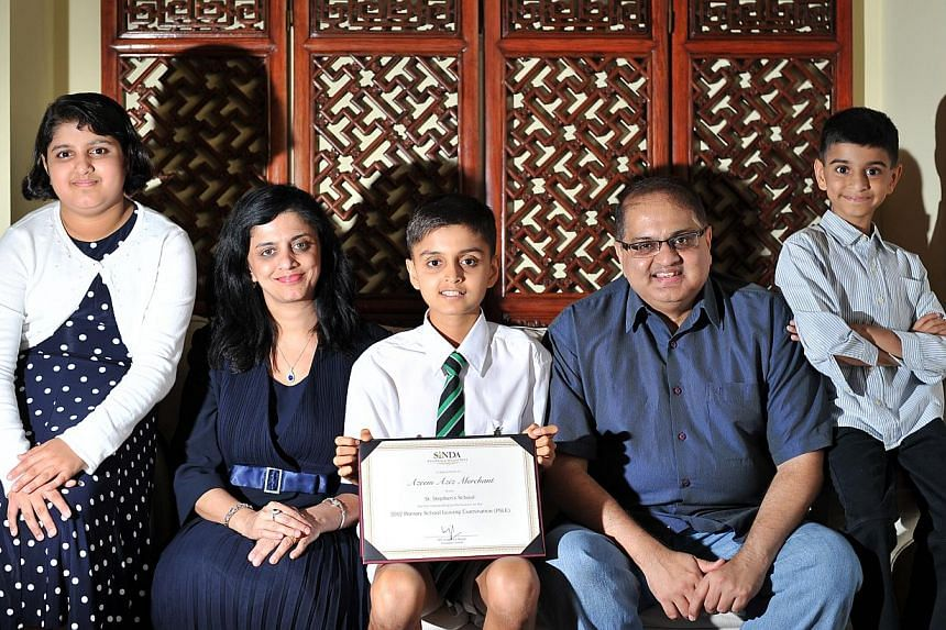 Former St Stephen's School pupil Azeem Aziz Merchant (centre), who was the second-highest scorer at last year's PSLE, was one of the recipients of this year's Sinda Excellence Awards. With him are (from left) his 11-year-old sister Farah; mother Resh