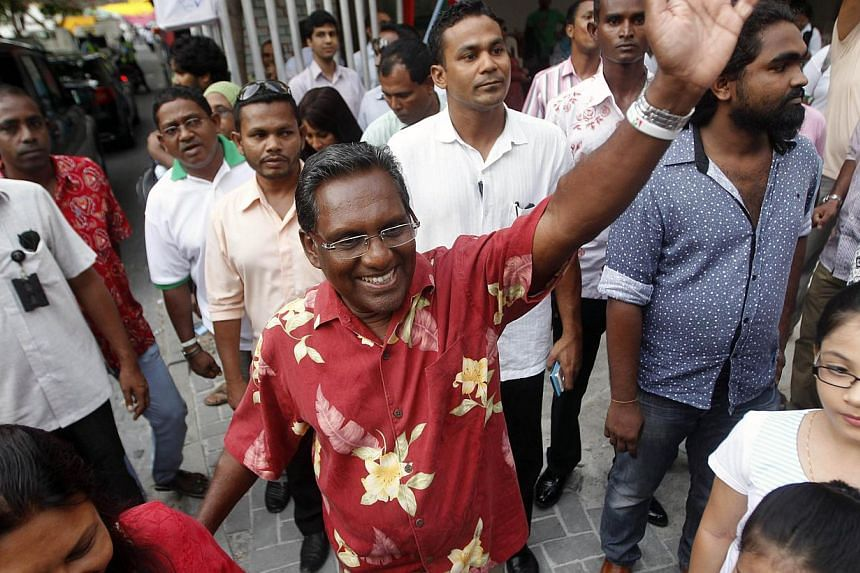 Maldivian presidential candidate and President Mohamed Waheed Hassan Manik (center) waves to supporters during a political meeting in Male Sept 6, 2013. Mr Waheed raises concerns on Sunday about the first round of the polls in which he suffered a hum