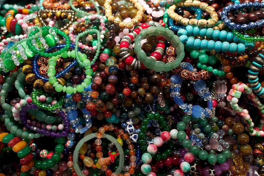 Jade bracelets for sale at the historic Jade Market near Temple Street in Kowloon, Hong Kong. Prized as a magical imperial stone, jade is a status symbol of the super rich in Asia, but rocketing prices in the top-end of the market have left traders i