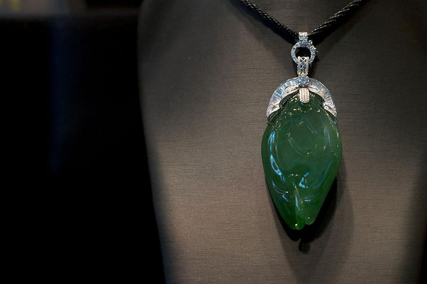 A pendant made from jade from Myanmar on display at the Hong Kong Jewellery and Gem Fair on Sept 13, 2013. -- FILE PHOTO: AFP