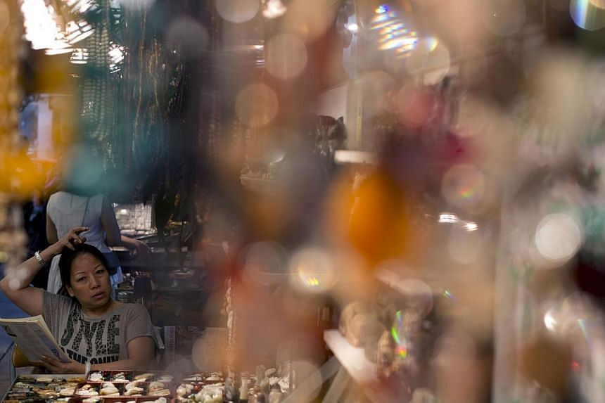 A vendor waiting for customers at the historic Jade Market near Temple Street in Kowloon, Hong Kong. -- FILE PHOTO: AFP