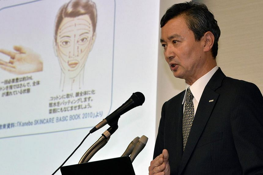 This picture taken on Sept 11, 2013 shows Japanese cosmetics company Kanebo president Masumi Natsusaka apologising over a recall of products blamed for leaving thousands of customers with skin blotches at a press conference in Tokyo. Japanese cosmeti