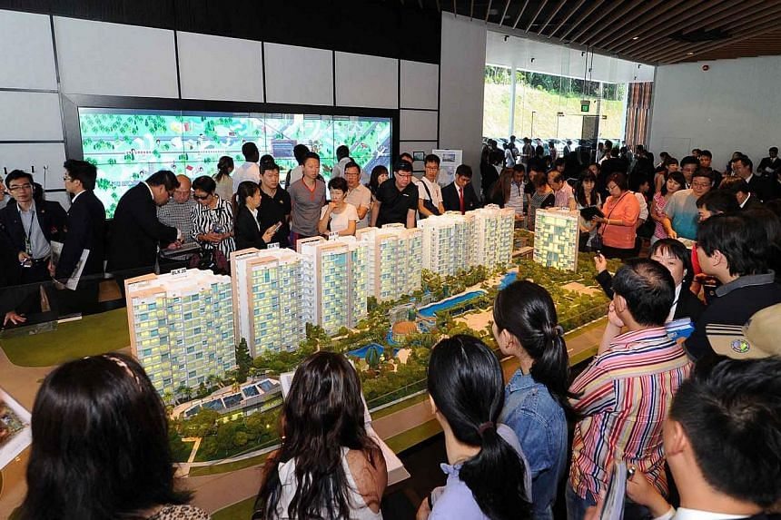Photo of a showflat at The Glades during its preview. Sales of new private homes rose 54 per cent from the preceding month to reach 742 units in August, beating analyst estimates. -- ST PHOTO: KEPPEL LAND