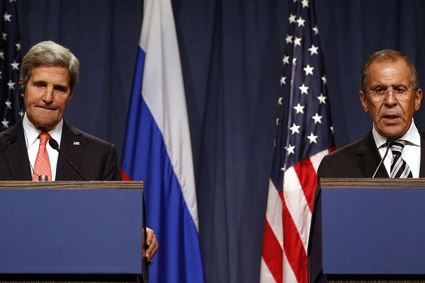 """U.S. Secretary of State John Kerry, left, pauses while Russian Foreign Minister Sergei Lavrov answers a question from the media, following meetings regarding Syria, at a news conference in Geneva, Switzerland, Saturday Sept. 14, 2013.""""We"""