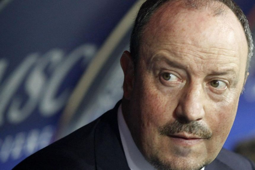 Napoli's coach Spanish Rafael Benitez looks on during the Italian Serie A football match SSC Napoli vs Atalanta BC in San Paolo Stadium on Sept 14, 2013.Napoli coach Rafael Benitez has played down his side's title challenge after they moved two