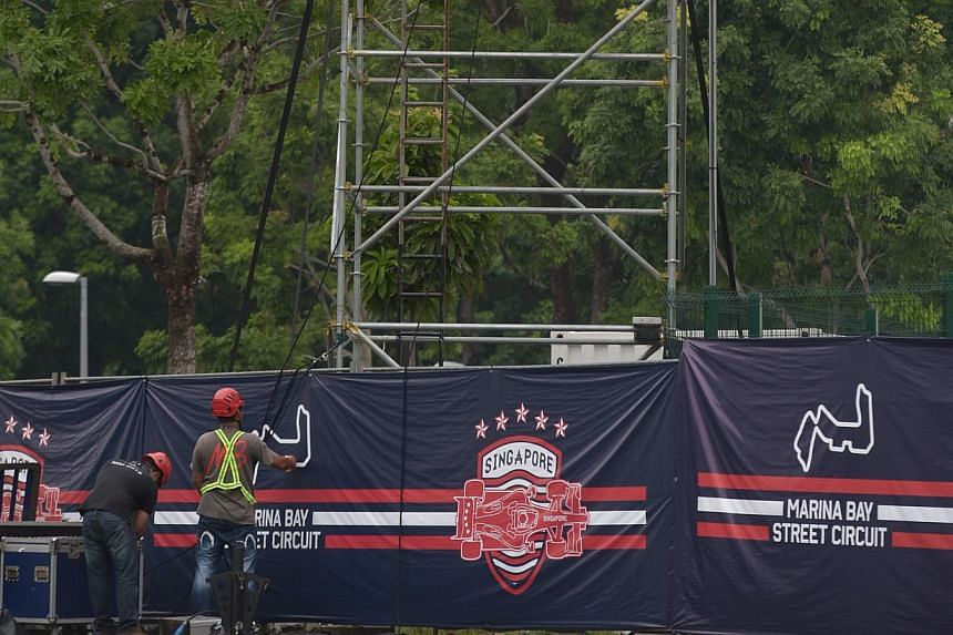 Equipmemt being put in place at the Village Stage, 15 September 2013. But even as Singapore awaits the roar of the Formula One cars' 2.4-litre V8 engines later this week, and last-minute touches are put on the Marina Bay Street Circuit, there is