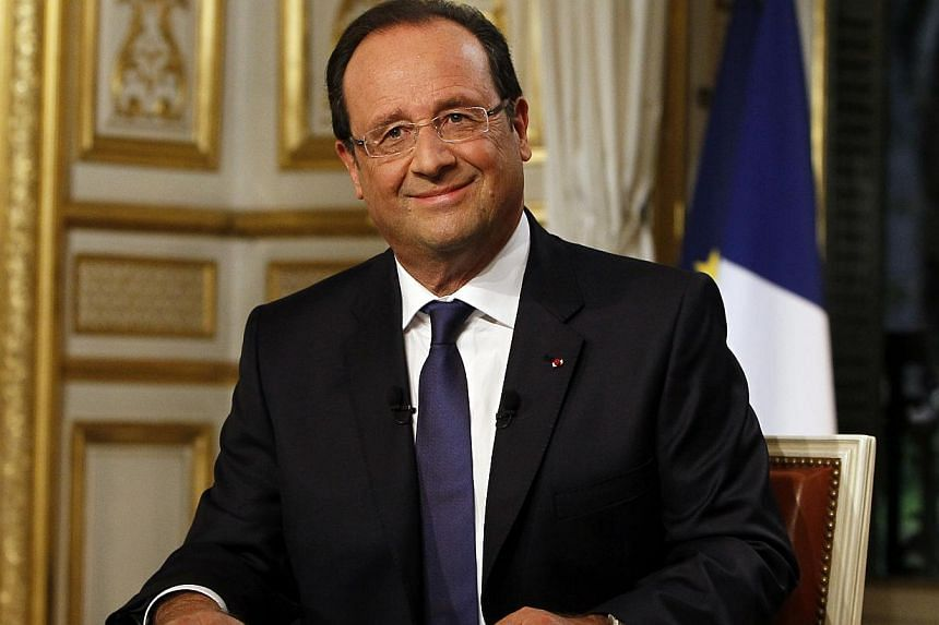 French President Francois Hollande takes part in a televised interview on a French TV channel, in Paris, Sunday, Sept. 15, 2013.  French President Francois Hollande will meet on Monday with Britain's top diplomat William Hague and US Secret