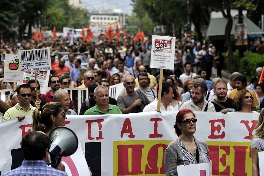 Greek school teachers march in central Athens during a demonstration on Monday, Sept 16, 2013. -- PHOTO: AFP