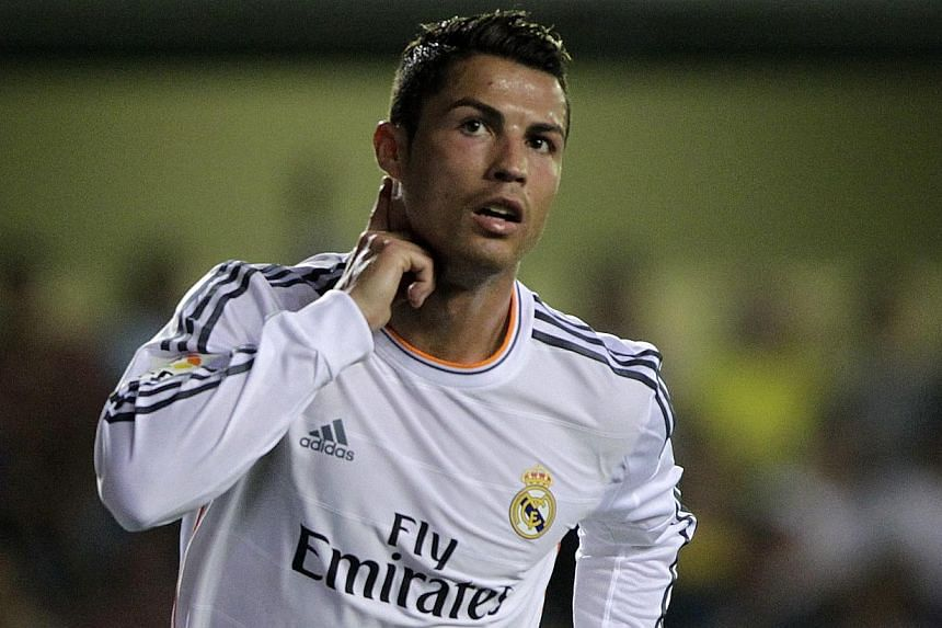 Real Madrid's Cristiano Ronaldo celebrates after he scored against Villarreal during their Spanish first division football match at the Madrigal stadium in Villarreal on Saturday, Sept 14, 2013.Ronaldo's unstoppable goal-scoring netted him a wo