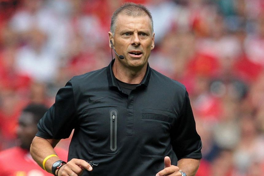 Former English Premier League official Mark Halsey is seen during the pre-season friendly football match between Liverpool and Olympiakos at Anfield Stadium in Liverpool, north-west England on Aug 3, 2013. Referees could be driven to commit