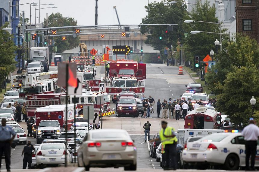 Emergency personnel respond to a reported shooting at the Washington Navy Yard in Washington on Monday, Sept 16, 2013. -- PHOTO: AP