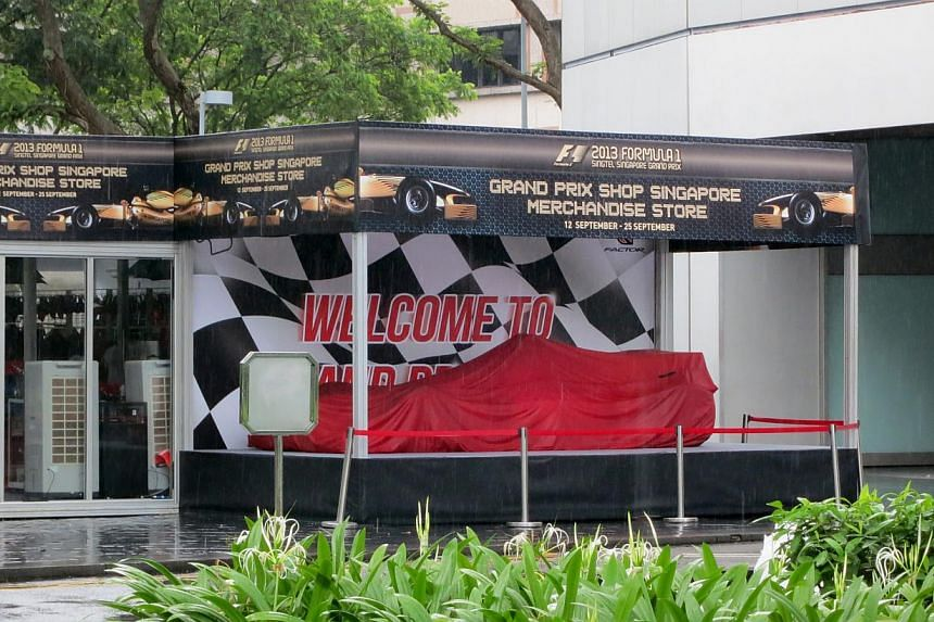 At Royal Plaza on Scotts, a life-sized car made of pasta sits in its lobby. This is the hotels fourth such  race car. Its chefs have created other life-sized race cars with chocolate, bread and macarons previously.  Workers laying artificial turf alo