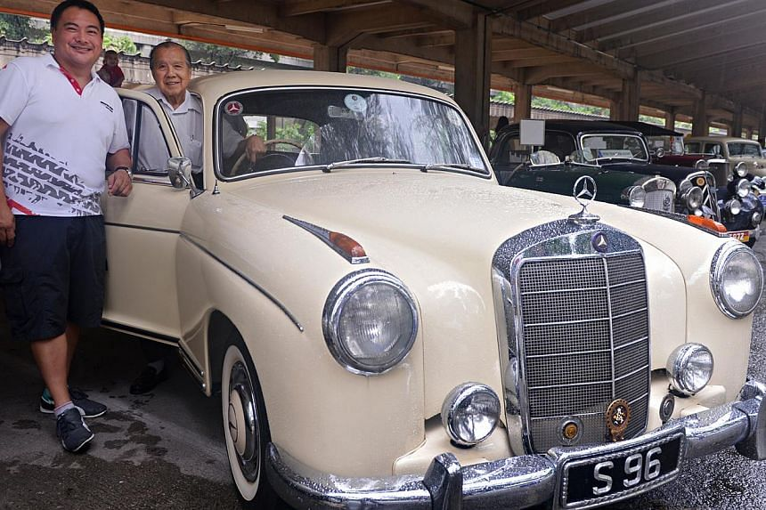 Mr Khoo Yeow Khim (right) and son Khoo Kay Hong with their 1955 Mercedes-Benz 220a.The classic car was one of 51 exhibited yesterday at the Motoring Heritage Day at the former Tanjong Pagar Railway Station.