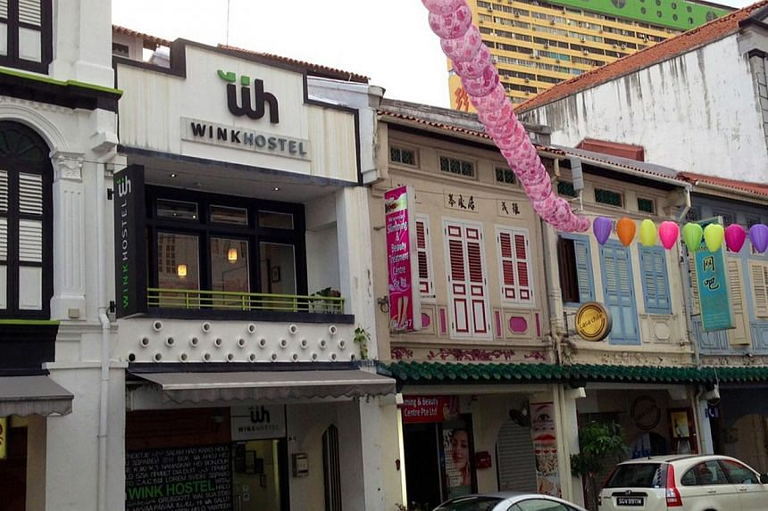 New hostels are opening up in areas such as Lavender (top left), Little India and Chinatown (above). As of July, there were 56 licensed hostels, compared with 46 last year, says the STB. They also offer attractive services, such as bike rentals, to m