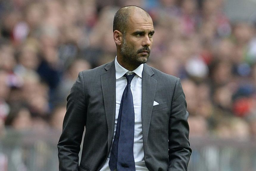 Bayern Munich's Spanish head coach Pep Guardiola watches the German first division Bundesliga football match Bayern Munich vs Hannover 96 in Munich, southern Germany, on Sept 14, 2013. Pep Guardiola makes his Champions League debut as Bayern Munich c