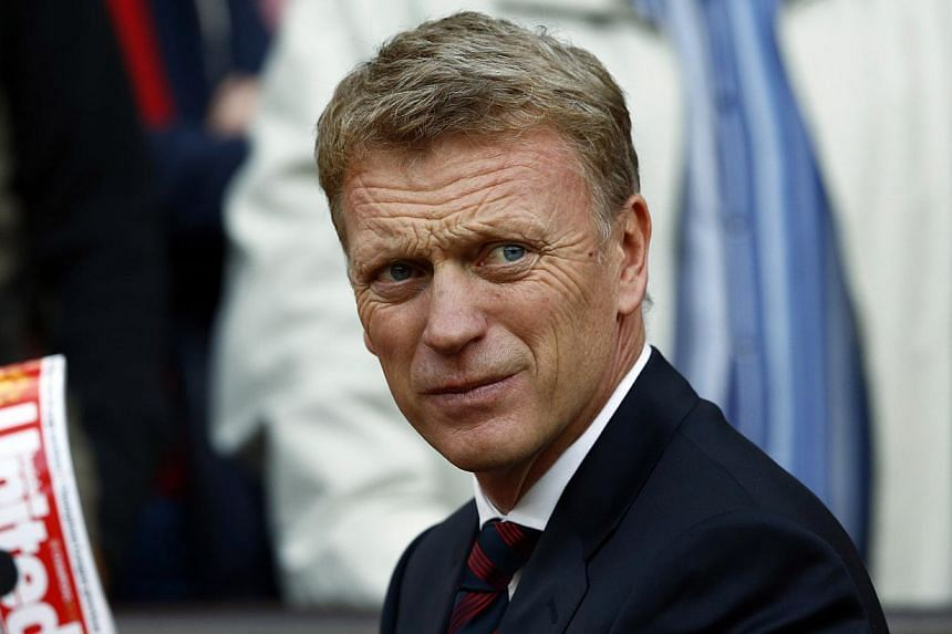 Manchester United's manager David Moyes watches his team during their English Premier League soccer match against Crystal Palace at Old Trafford in Manchester, northern England on Sept 14, 2013. David Moyes will sample the Champions League group phas
