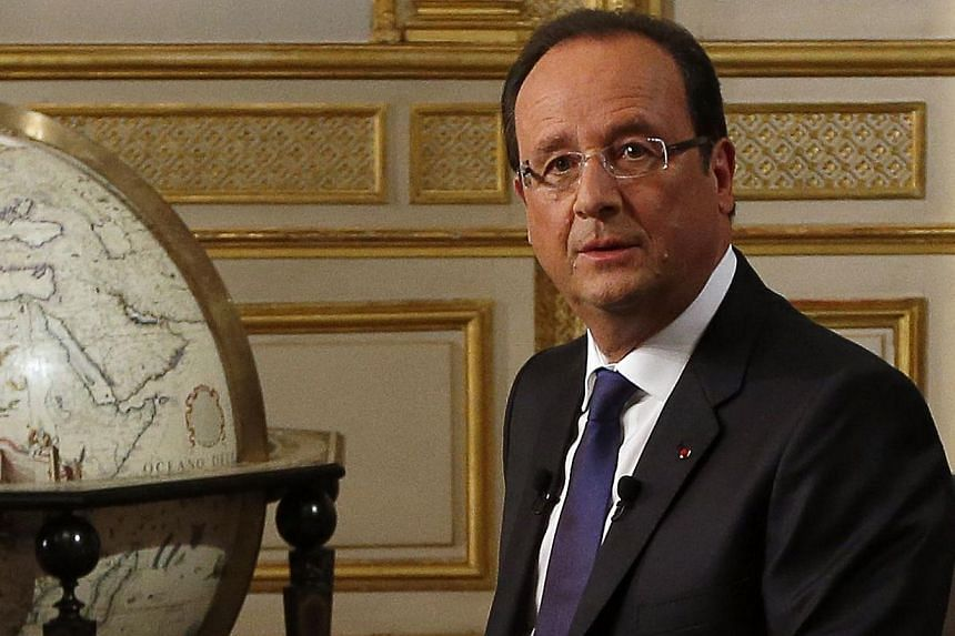 """French President Francois Hollande warned Sunday a US-Russian deal reached over the weekend to eradicate Syria's chemical arms arsenal was """"not an end point"""", adding the option of military strikes must remain on the table. -- PHOTO: AP"""