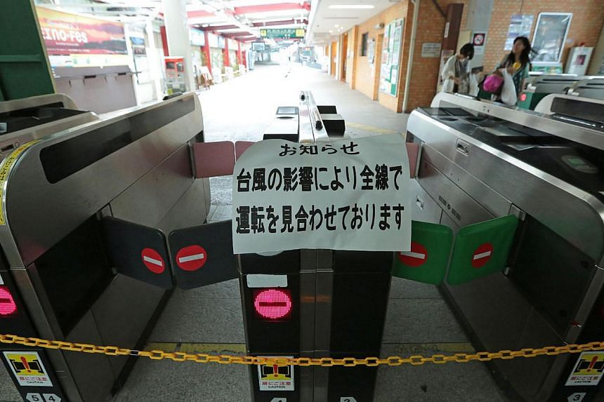 Automatic ticket gates are closed as train services were suspended at the Kamakura station of the Enoshima Electric railway in Kamakura, suburban Tokyo on Sept 16, 2013. Typhoon Man-yi hit southern Japan on Monday, bringing heavy rains as officials w