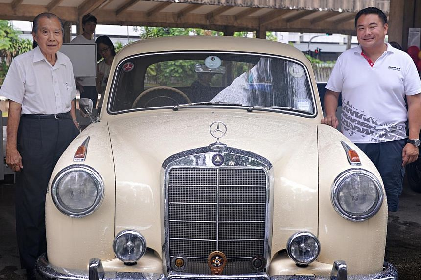Motoring Heritage Day shows off 50 vintage cars and 10 restored bicycles at Tanjong Pagar Railway Station. Mr Khoo Yeow Khim (left), 82, and Mr Khoo Kay Hong, 42, with their 1955 Mercedes-Benz 220a. -- ST PHOTO: NURIA LING