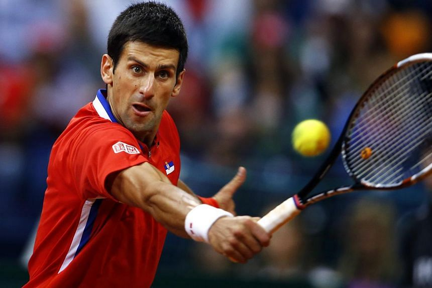 Novak Djokovic (above) and Janko Tipsarevic led Serbia into a Davis Cup final clash with defending champions the Czech Republic on Sunday after over-turning a 2-1 deficit to beat Canada 3-2 in the semi-finals. -- PHOTO: REUTERS