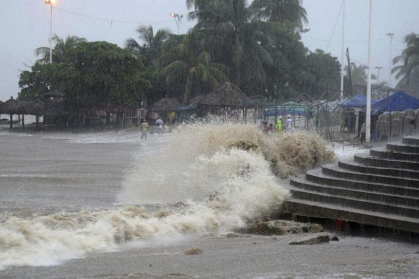 Rain water pours into the beach due to heavy rains caused by Tropical Storm Manuel in the Pacific resort city of Acapulco, Mexico, Sunday, Sept 15, 2013. Hurricane Ingrid and Tropical Storm Manuel triggered rain, landslides and floods as they neared