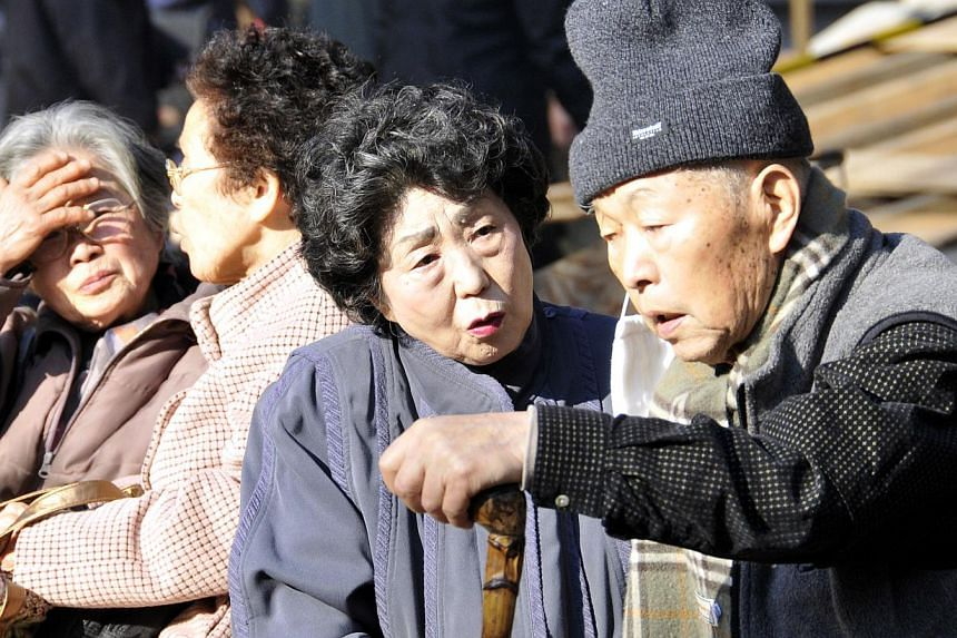 Elderly people sit in the sun and chat each other at Tokyo's Sugamo district on December 20, 2008. Tokyo is well-known for its hip districts for young people, but as Japan's population ages, a new type of fashionable area is coming into vogue, a hub