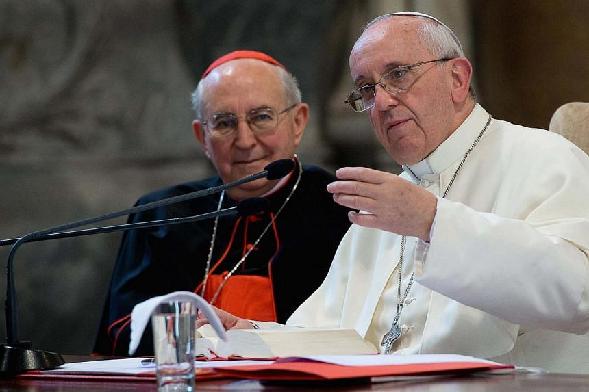 """Pope Francis speaks next to Cardinal Agostino Vallini (left) during Francis' visit to the Roman Diocese in Basilica of Saint John Lateran in Rome, on Sept 16, 2013. Pope Francis on Monday called for """"another way"""" of treating divorcees who remarry - a"""