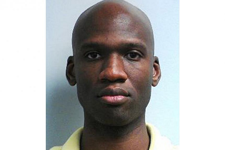 This image released by the FBI shows a photo of Aaron Alexis, who police believe was a gunman at the Washington Navy Yard shooting in Washington, Monday morning, Sept 16, 2013, and who was killed after he fired on a police officer. Aaron Alexis, the