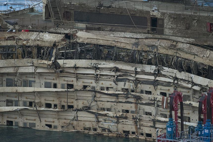 A detail of the right side of the Costa Concordia is seen after it was lifted upright, on the Tuscan Island of Giglio, Italy on Tuesday, Sept 17, 2013. -- PHOTO: AP