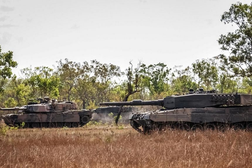 Singapore Armed Forces (right) and Australian Defence Force (left) Main Battle Tanks involved in a manoeuvre exercise. Close to 100 Singapore Armed Forces (SAF) personnel are training with their Australian counterparts in a bilateral armour exer