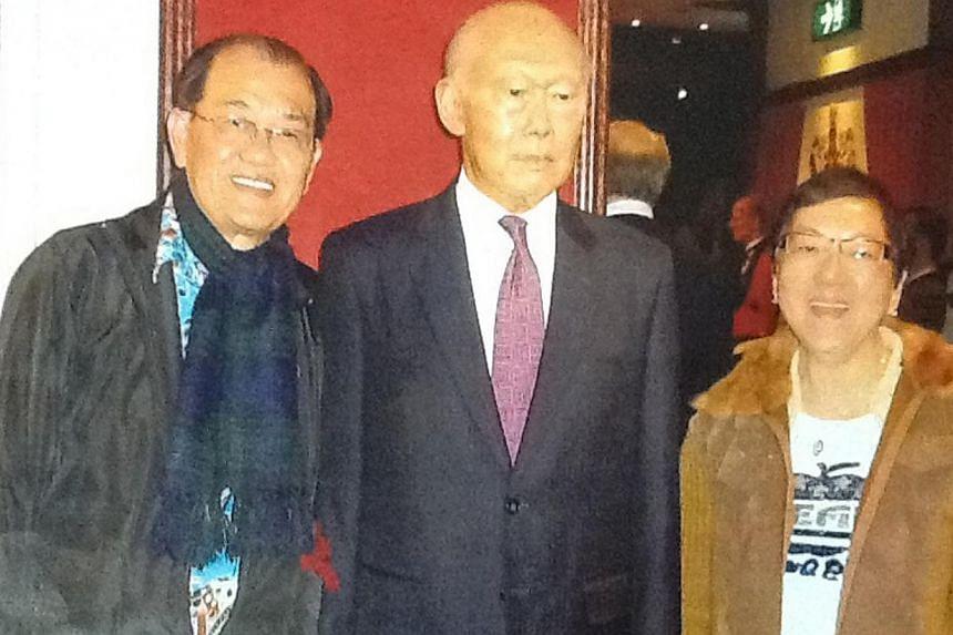 Mr and Mrs Patrick Tan with a wax figure of Mr Lee Kuan Yew at Madame Tussauds Hong Kong. -- PHOTO: PATRICK TAN