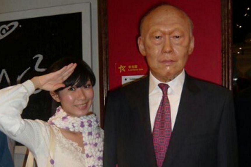 Ms Angie Than Bi Xia posing next to a wax figure of Mr Lee Kuan Yew. -- PHOTO: ANGIE THAN BI XIA