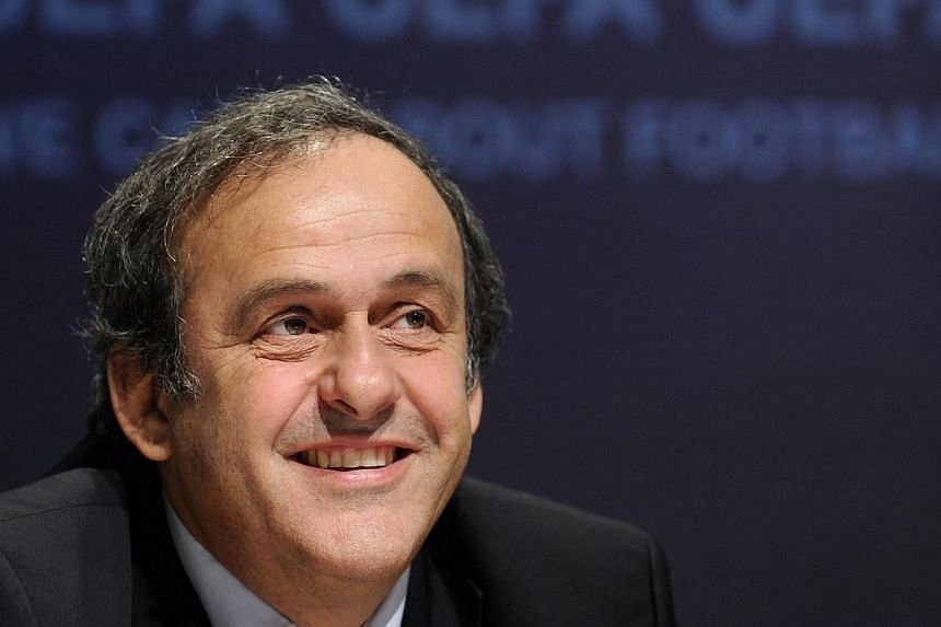 Uefa president Michel Platini smiles during a press presentation of the new Uefa Club licensing and Financial Fair Play Regulations, at the European governing body headquarters in Nyon on Jan 11, 2011.Platini said on Tuesday, Sept 17, 2013, tha