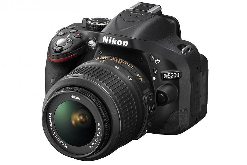 Readers of The Straits Times stand a chance to win a Nikon D5200 camera kit worth $1,319 (above), courtesy of Nikon Singapore.-- PHOTO: NIKON