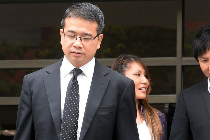 (Top) Lawyer Edwin Tong (foreground), seen here with his client Kong Hee and Kong's wife Ho Yeow Sun, crossed swords with auditor Foong Daw Ching (above) on the witness stand yesterday.