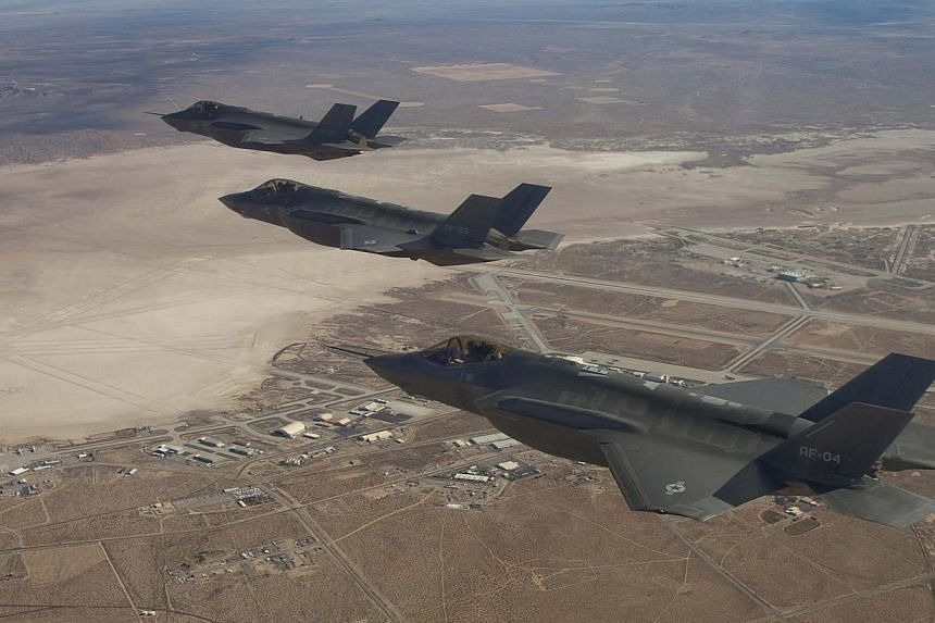 Three F-35 Joint Strike Fighters (from rear) AF-2, AF-3 and AF-4, can be seen flying over Edwards Air Force Base in this Dec 10, 2011, handout photo provided by Lockheed Martin.The Netherlands will purchase 37 F-35 Joint Strike Fighter planes,