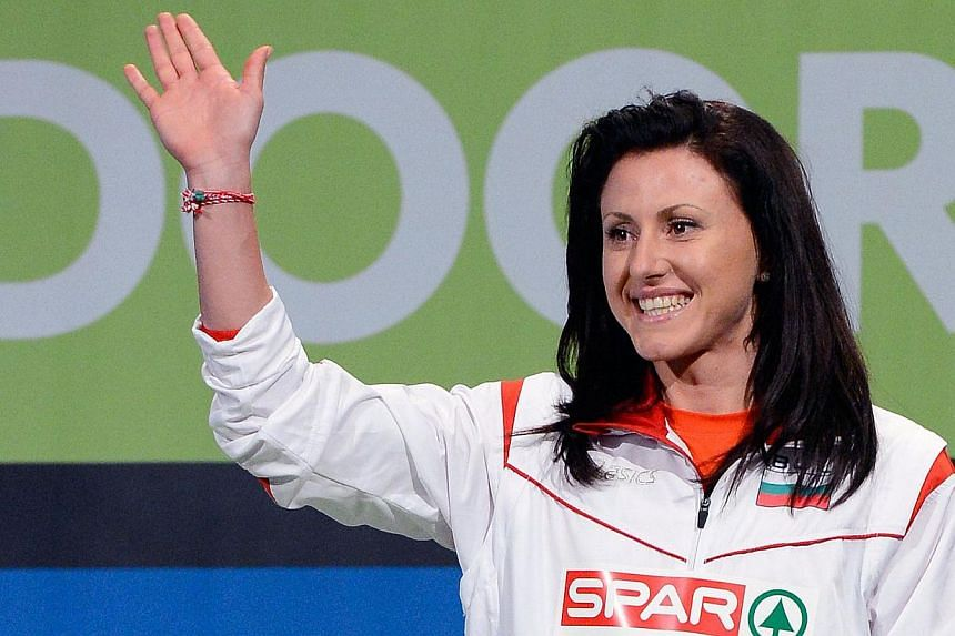 Bulgaria's Tezdzhan Naimova celebrates on the podium after winning the 60m final at the European Indoor Athletics Championships in Gothenburg, Sweden on March 3, 2013.Naimova has been banned for life after testing positive for the banned steroi