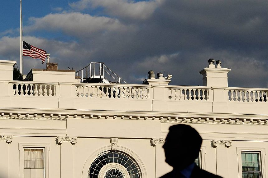The United States (US) national flag flies half-mast at the White House in Washington on Sept 16, 2013. US President Barack Obama ordered flags be lowered to half mast until Friday after a mass shooting at a naval base in the US capital left 13 dead