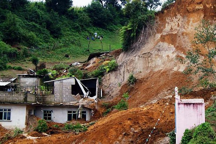 View of a landslide caused by heavy rains in Xaltepec community, State of Veracruz, Mexico on Sept 16, 2013. -- PHOTO: AFP