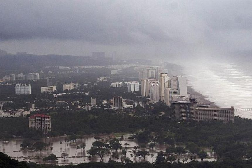 View of the flooded area in Acapulco, Guerrero state, Mexico, after heavy rains hit the area on Sept 16, 2013. -- PHOTO: AFP