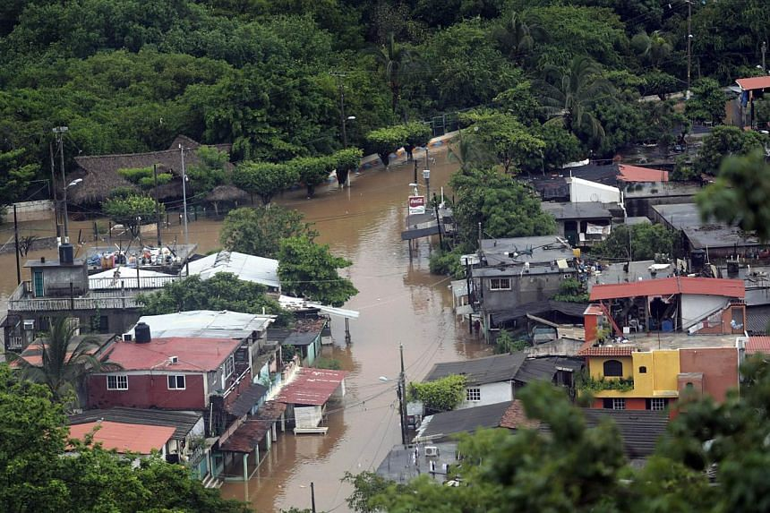 View of the flooded area in Puerto Marques in Acapulco, Guerrero state, Mexico, after heavy rains hit the area on Sept 16, 2013. -- PHOTO: AFP
