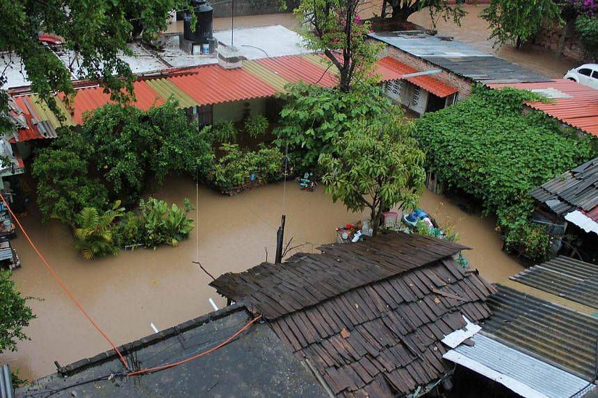 Aerial view of houses flooded in Chilpancingo city, Guerrero state, Mexico on Sept 16, 2013. -- PHOTO: AFP