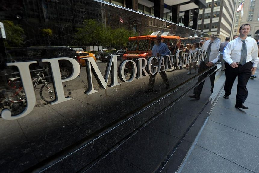 """JPMorgan Chase will pay at least US$700 million (S$883.3 million) in fines as part of a settlement linked to its handling of its """"London whale"""" trading loss, The Wall Street Journal reported on Monday. -- PHOTO: AFP"""