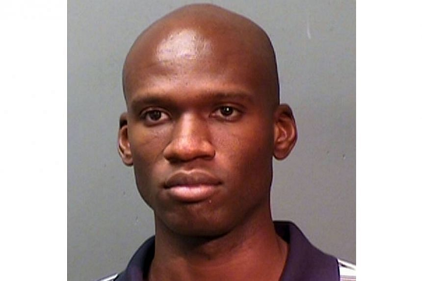 This booking photo provided by the Fort Worth Police Department shows Aaron Alexis, arrested in September 2010, on suspicion of discharging a firearm in the city limits. Alexis is suspected to be the shooter at the Washington, DC Navy Yard on Monday,