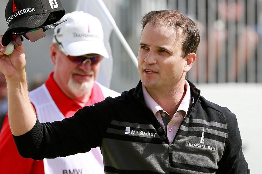 Zach Johnson fired a bogey-free 65 in Monday's final round to win the weather-delayed BMW Championship at Conway Farms Golf Club in Lake Forest, Illinois, and move into great position for the Tour Championship. -- PHOTO: AFP