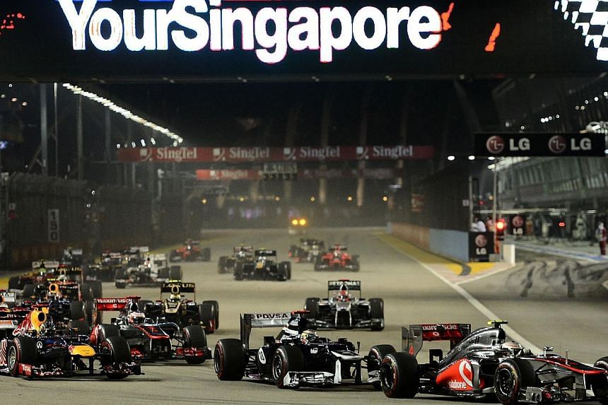 A shot from the 2012 Formula One (F1) SingTel Singapore Grand Prix. POSB is inviting over 1,000 customers to watch the F1 race this weekend, it said on Wednesday, Sept 18, 2013. -- ST FILE PHOTO: MUGILAN RAJASEGERAN