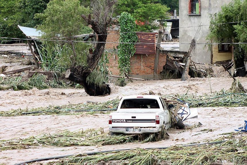 View of a flooded area in Chilpancingo, state of Guerrero, Mexico, on September 17, 2013.Mexican authorities scrambled Tuesday to launch an air lift to evacuate tens of thousands of tourists stranded amid floods in the resort of Acapulco follow