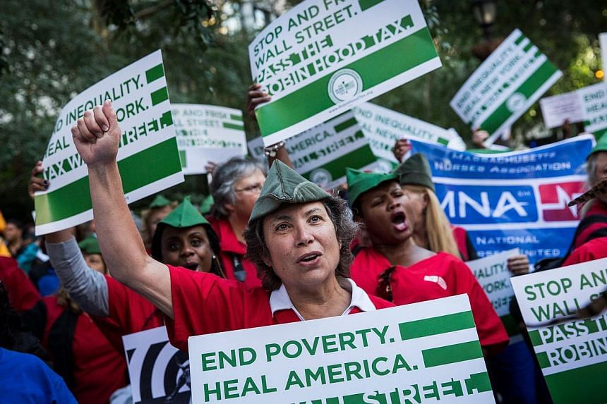 """Occupy Wall Street protesters attend a rally outside the United Nations building prior to marching to Bryant Park on September 17, 2013 in New York City.""""Occupy Wall Street"""" returned to the streets of New York on Tuesday to mark the"""