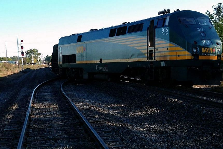 A Via Rail passenger train sits on the tracks at a crossing in Ottawa, Ontario, after a collision with a city buson Wednesday, Sept. 18, 2013.-- PHOTO: AP