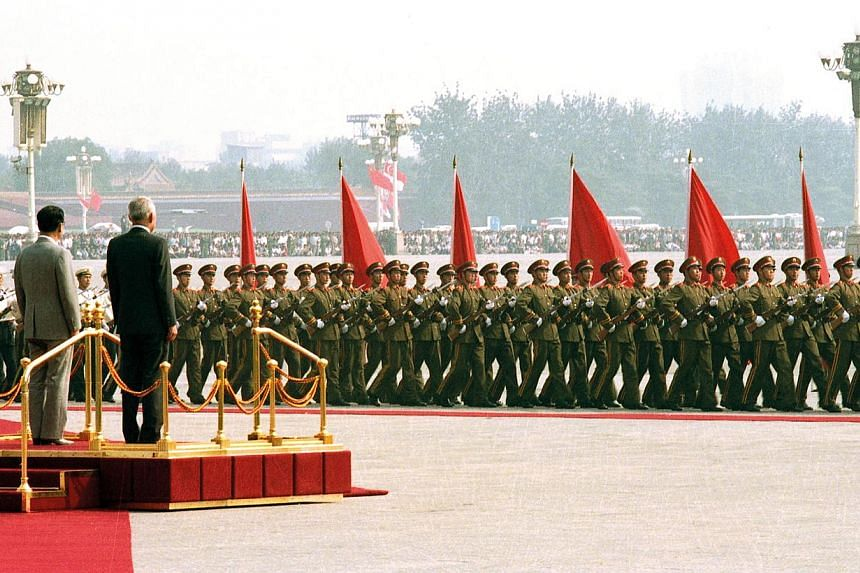 Mr Lee (on podium, right) with Chinese Premier Li Peng at a welcome ceremony at the Great Hall of the People during his nine-day visit to China in September 1988, when he also met Chinese President Yang Shangkun, General Secretary of the Chinese Comm